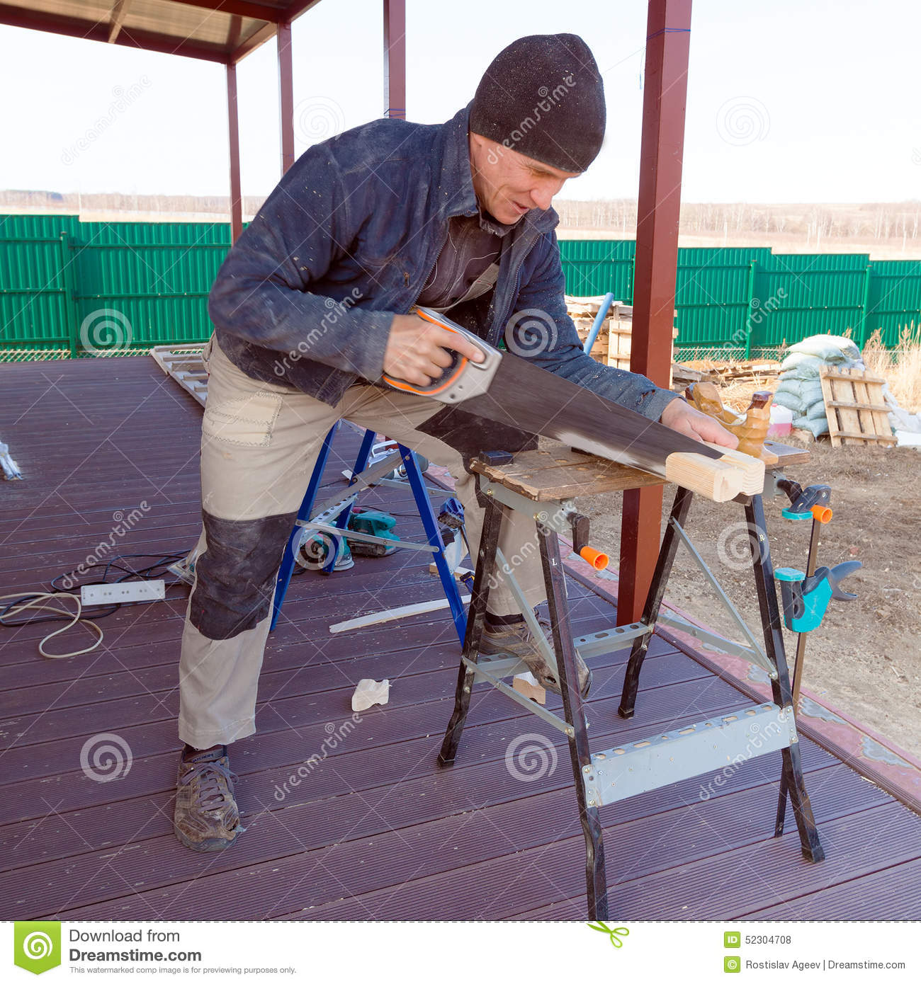 Carpenter with Saw Outdoor