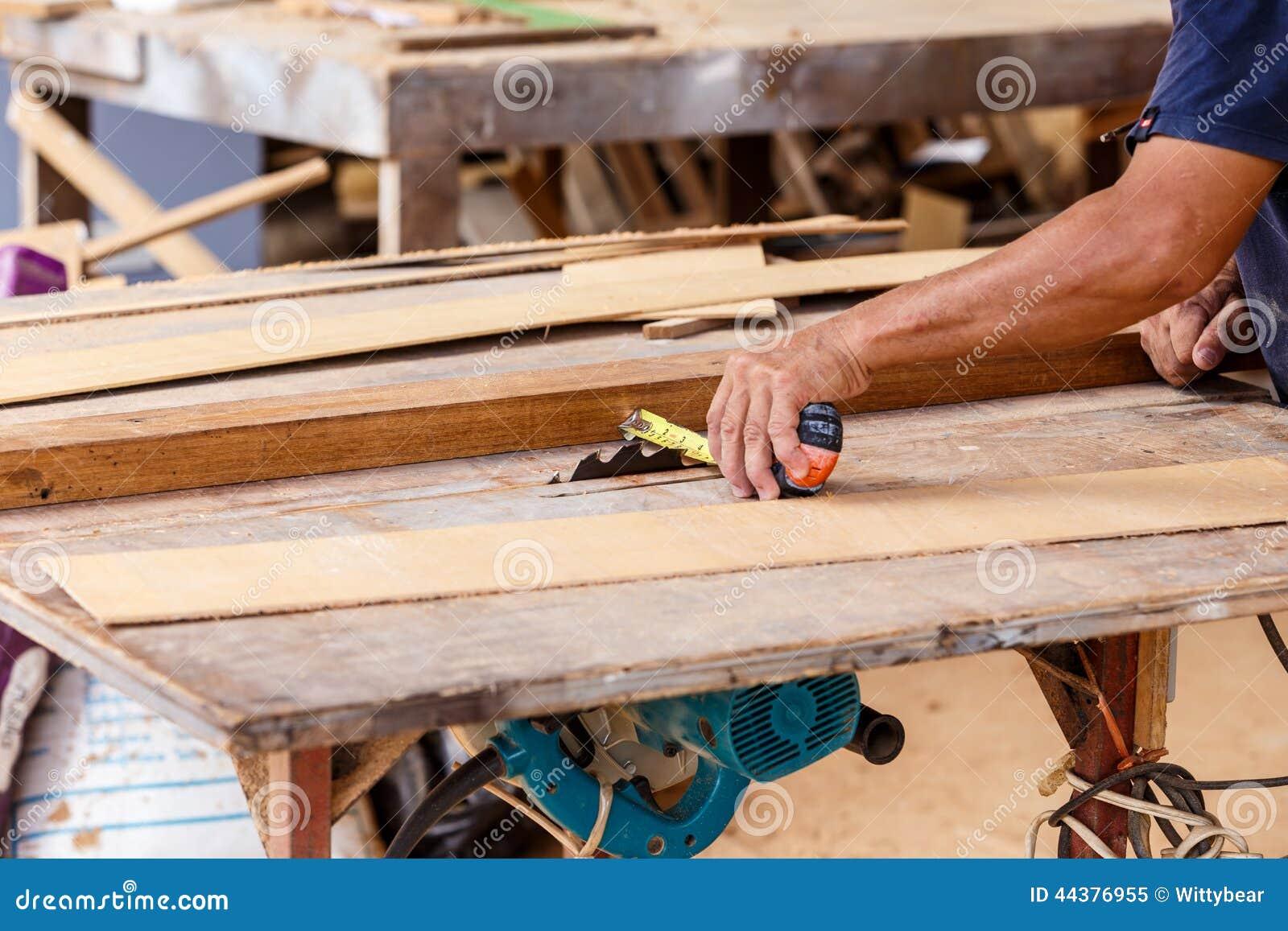 carpenter use saw cut wood for make new furniture stock photo image 44376955. Black Bedroom Furniture Sets. Home Design Ideas