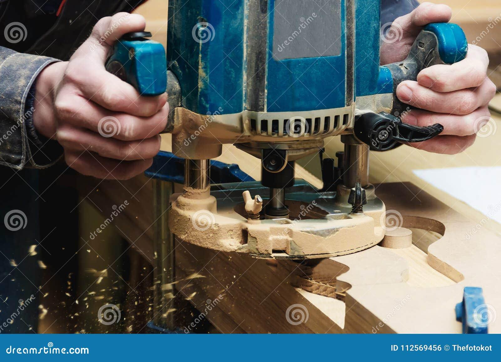 Carpenter Working of Manual Milling Machine in Carpentry Workshop. Industrial Manufactoring Concept.