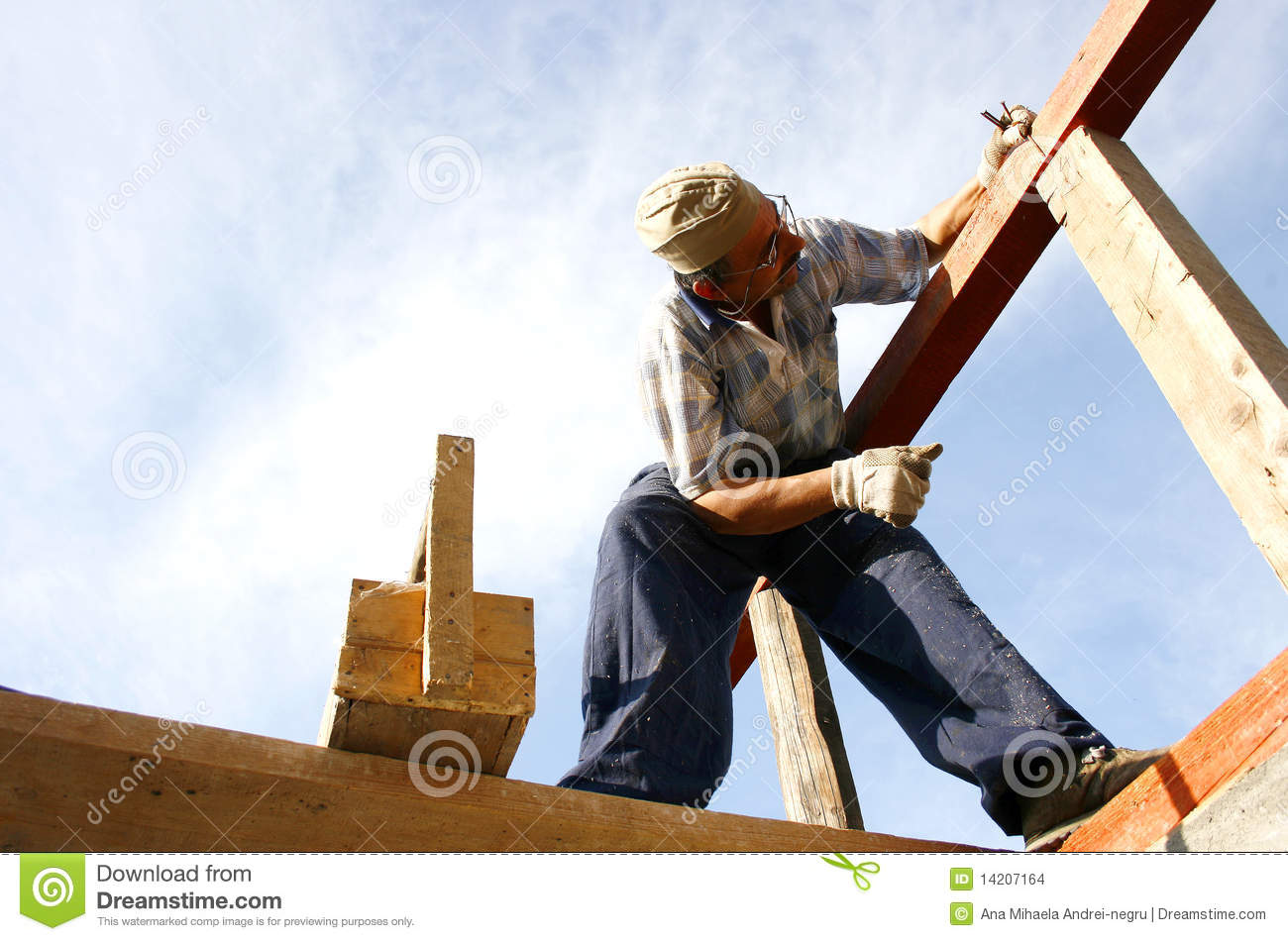 Carpenter Working With Nails And A Box Of Tools Stock ...