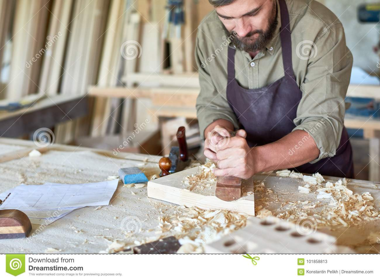 Carpenter Working In Traditional Woodworking Shop Stock Image