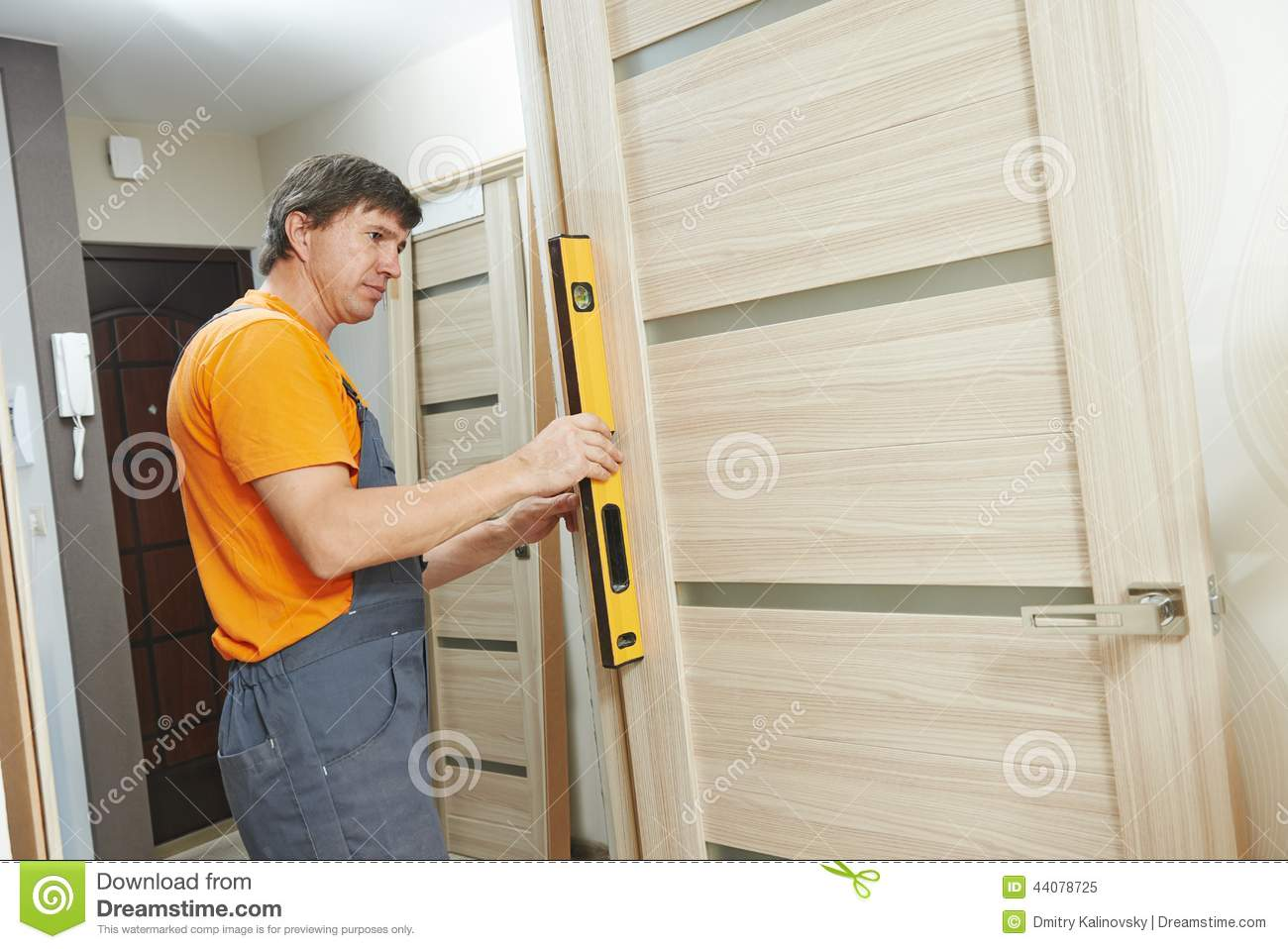 Carpenter works with level stock image image of manual - Interior door installation instructions ...