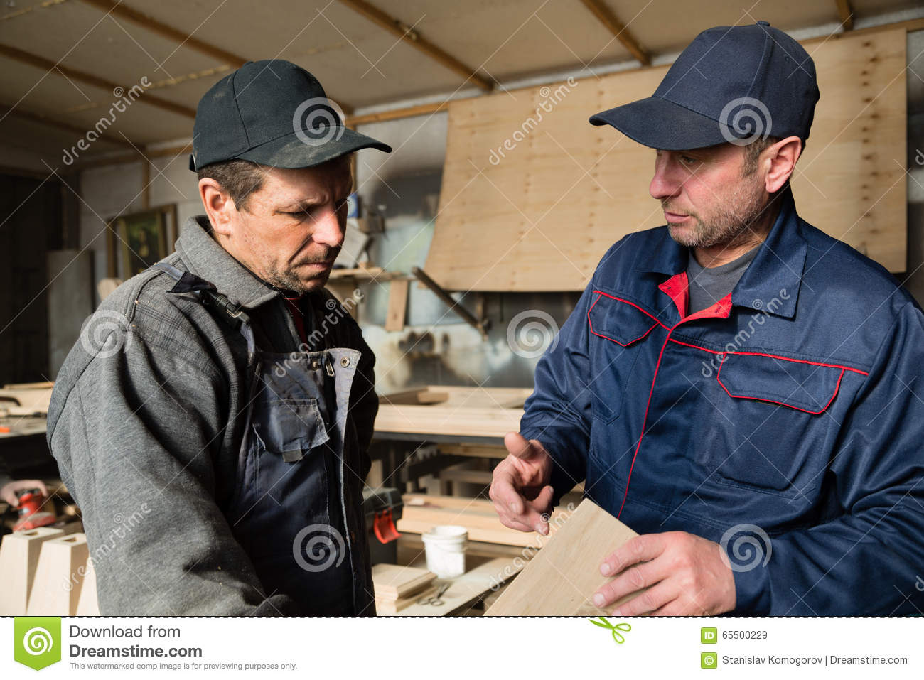 Carpenters discuss manufacturing products for the furniture.