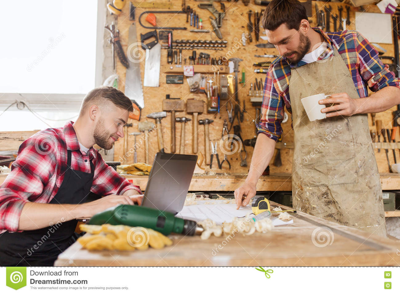 Carpenters with laptop and blueprint at workshop stock image image royalty free stock photo malvernweather Images