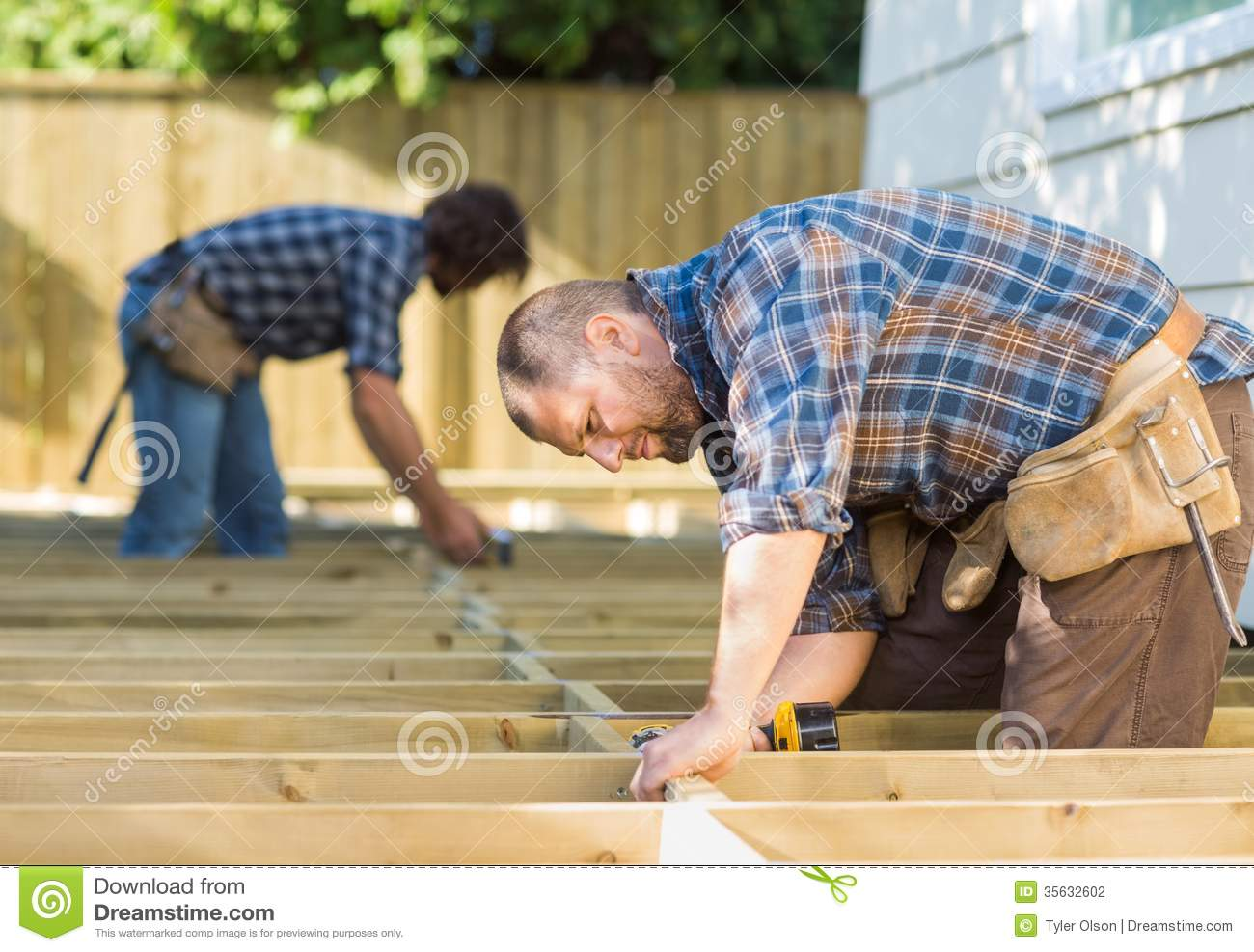 Carpenters working at construction site stock photography image 35632602 - Terras hout ...