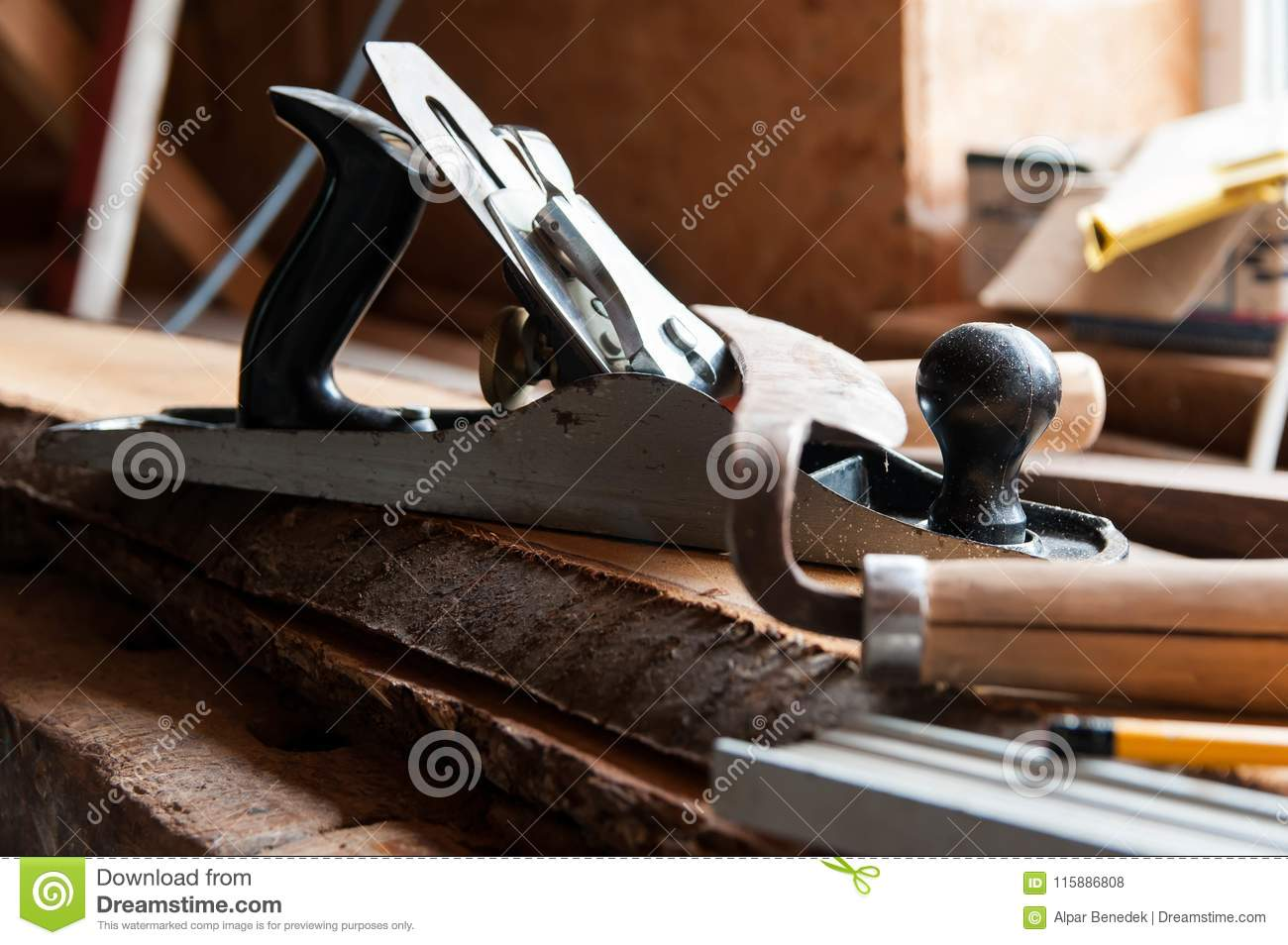 Carpentry tools on wood boards, focus on the plane