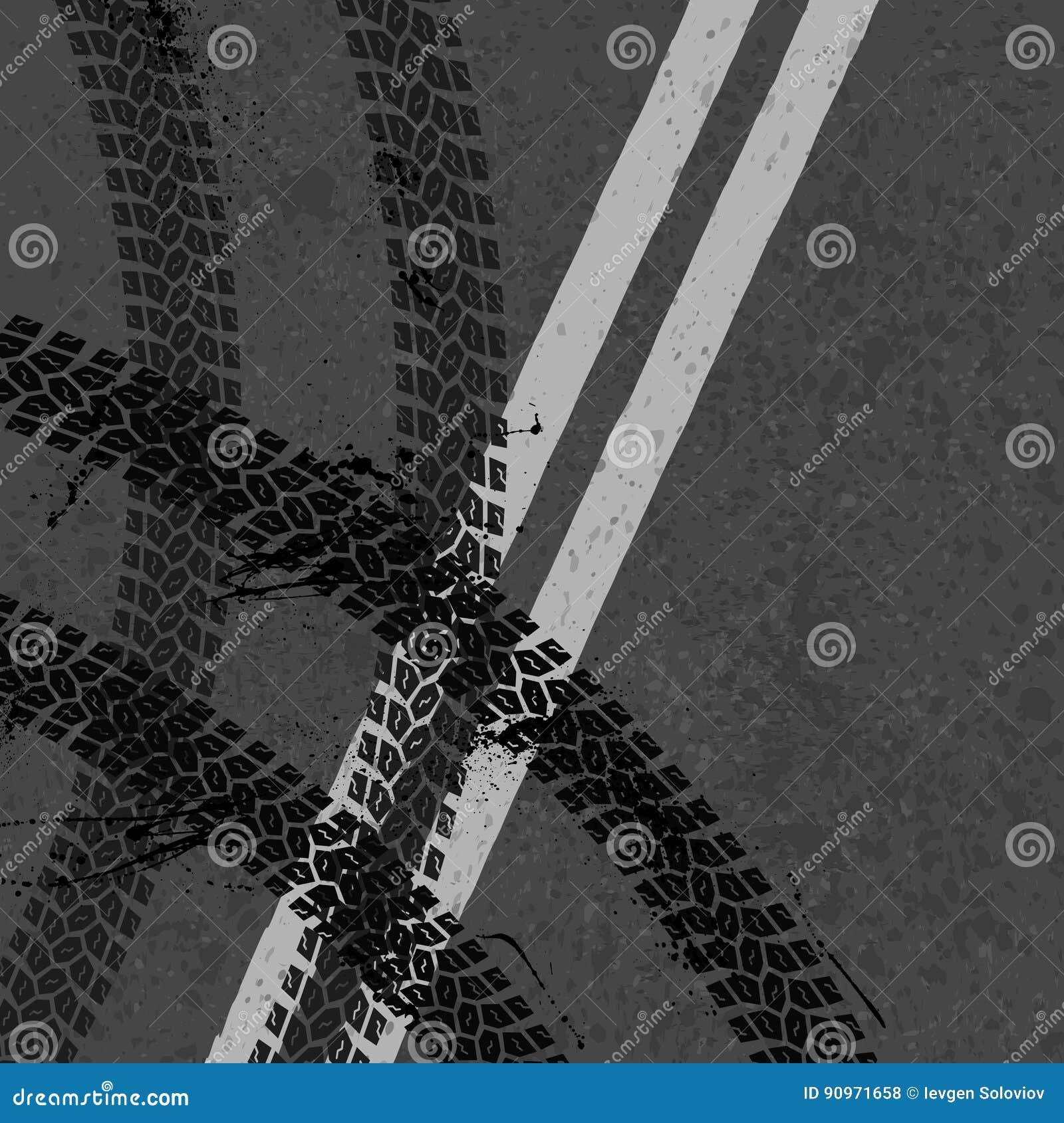 Carretera de asfalto con las pistas del neumático