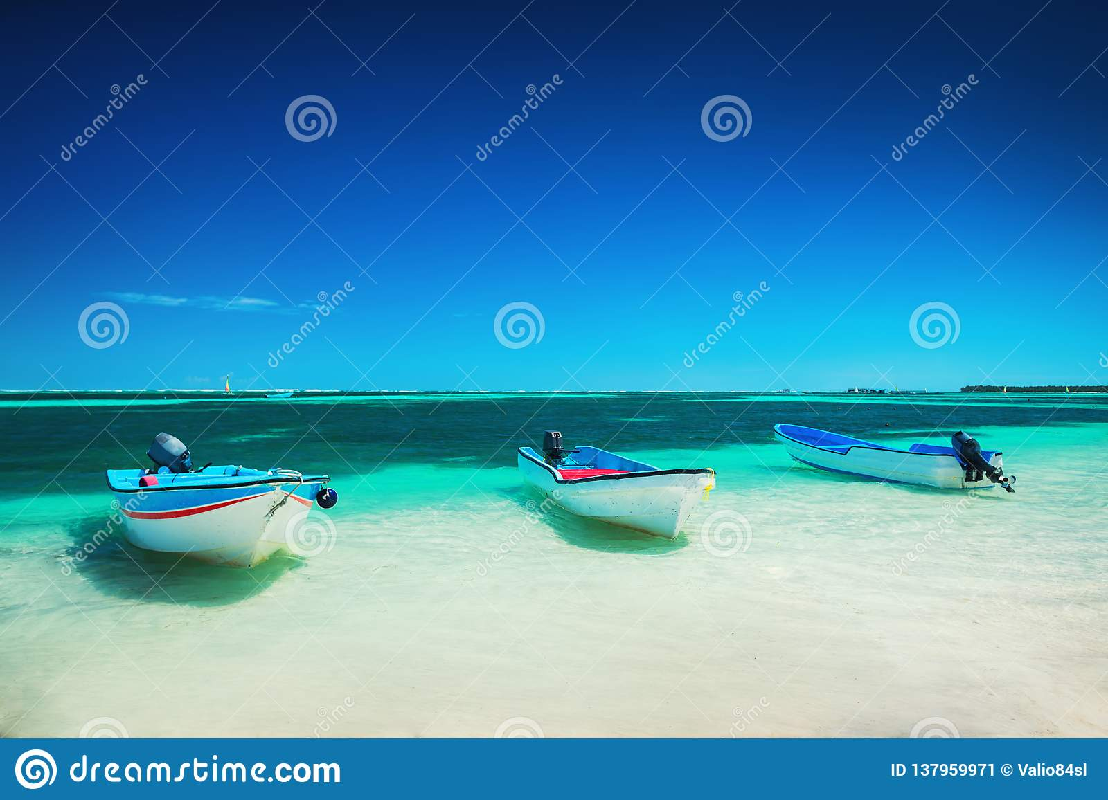 Caribbean sea and speed boats on the shore of Punta Cana, beautiful panoramic view