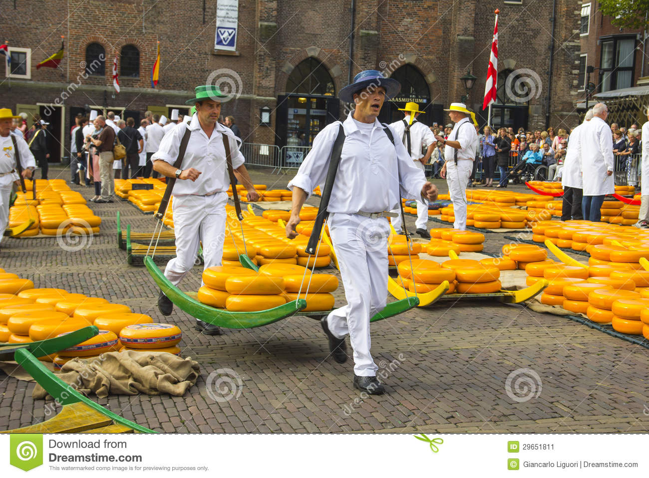 Carriers walking with cheeses in the Dutch cheese market