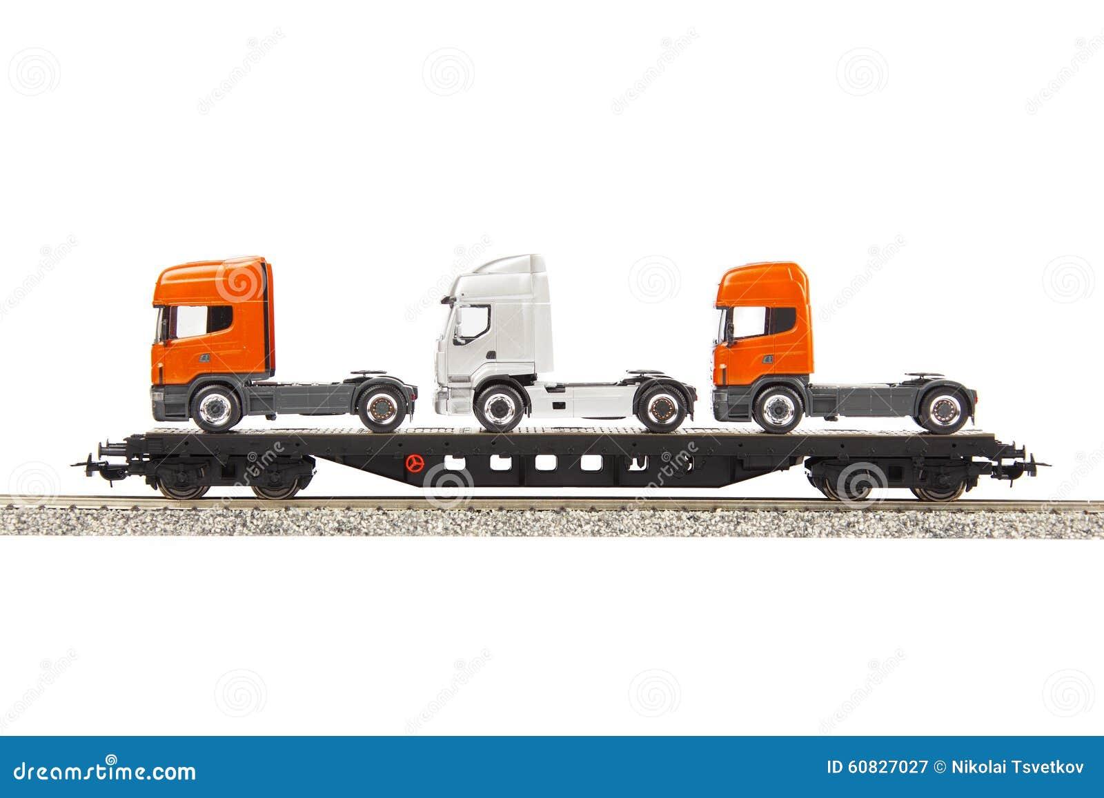 Carro del cargo del juguete con los camiones