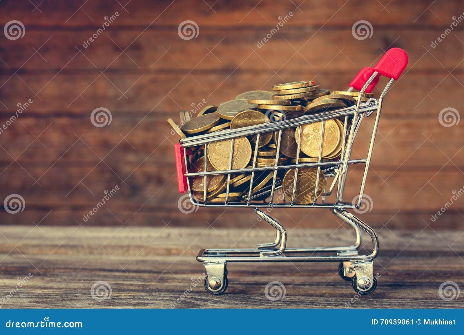 Carro y monedas de compras