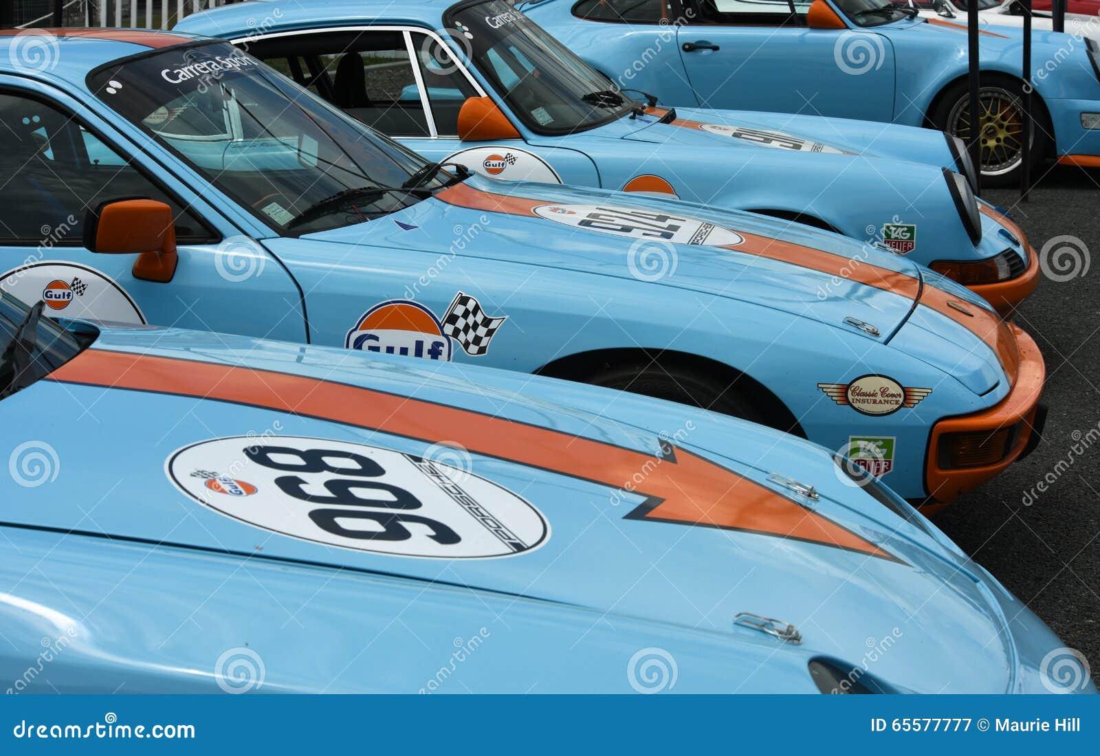 Carros de competência de Porsche na libré do golfo