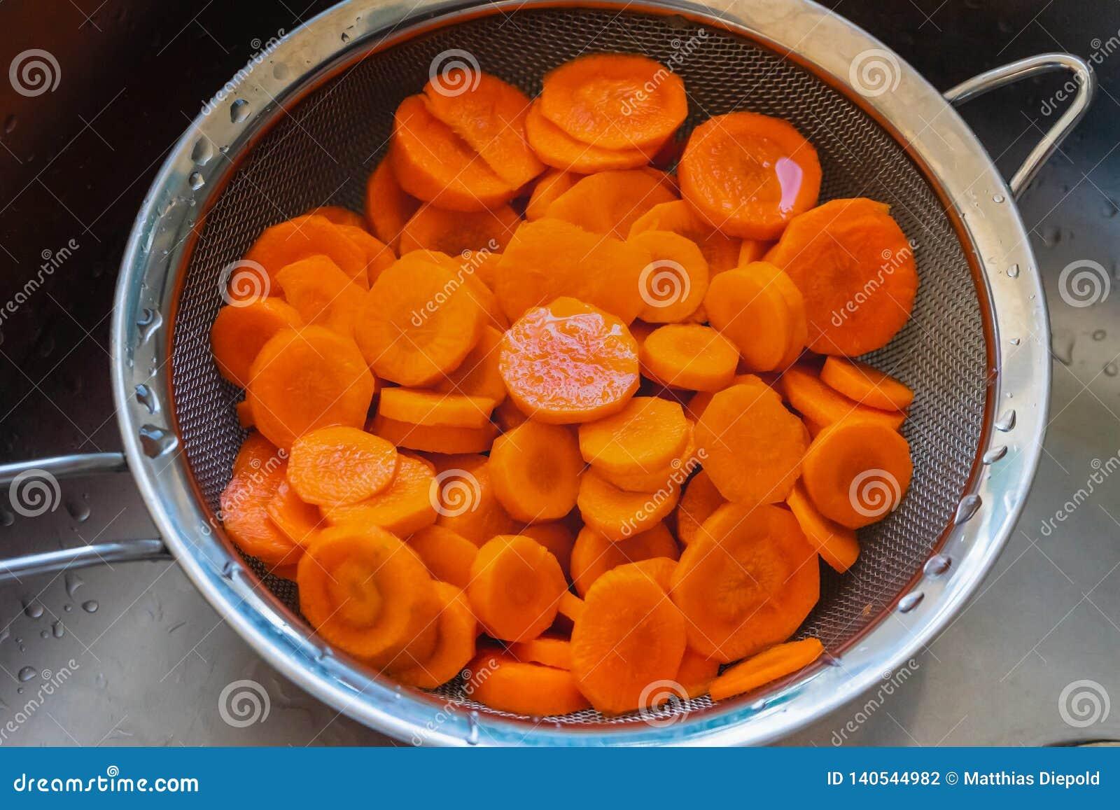 Carrots cut in a sieve