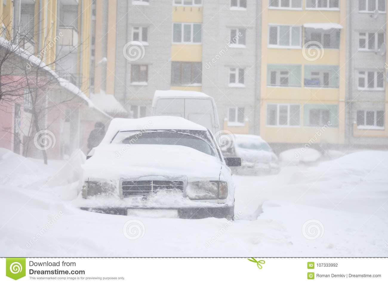 Cars blocked by snow, snow-paralysis of traffic, snow covered street, blizzard, front view, winter weather, work for utility compa