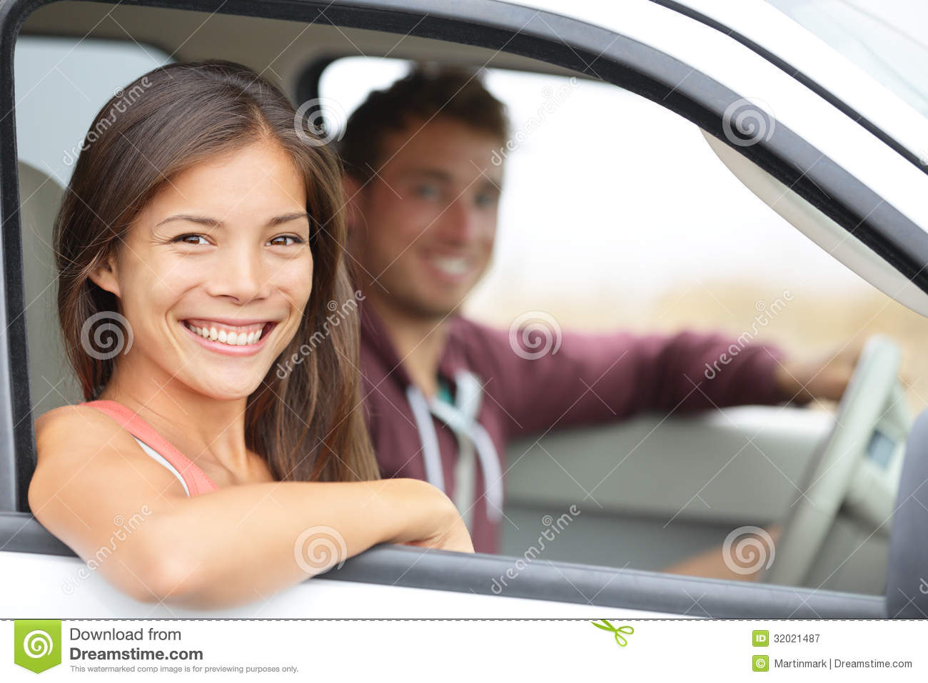 Cars - couple driving in new car smiling happy