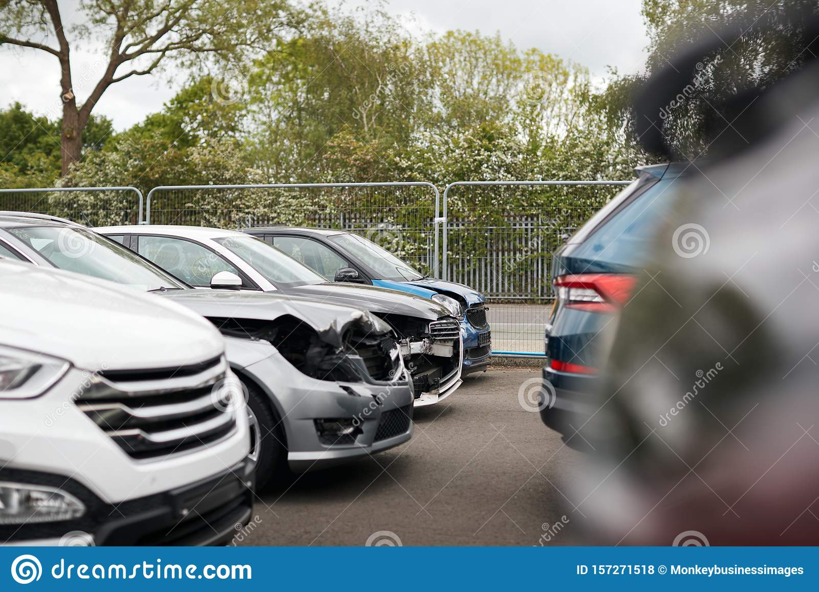 Cars Damaged In Motor Vehicle Accidents Parked In Garage ...