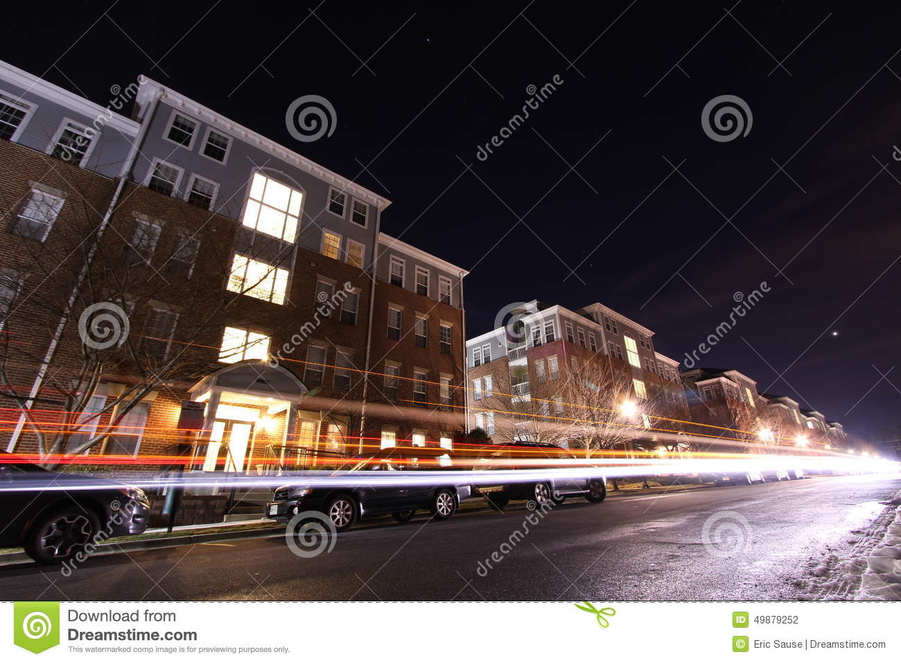 Cars Drive By Apartment Building Complex At Night Editorial