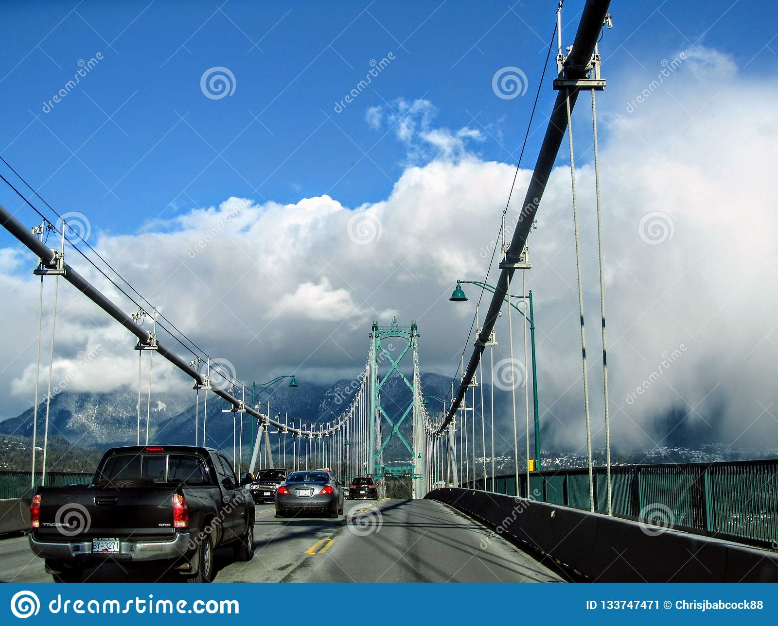 Cars driving across the Lions Gate Bridge, which crosses from Stanley Park to North Vancouver.