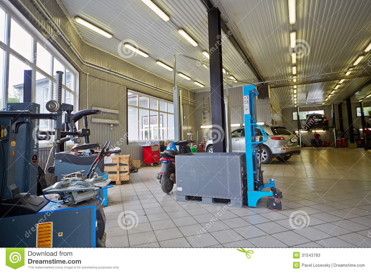 Cars And Equipment In Workshop Of Service Station
