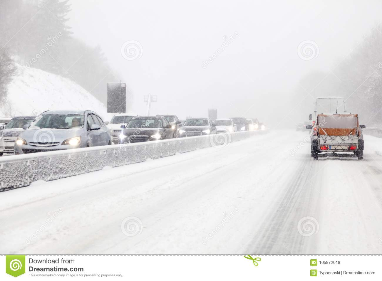 Cars on the highway during a blizzard