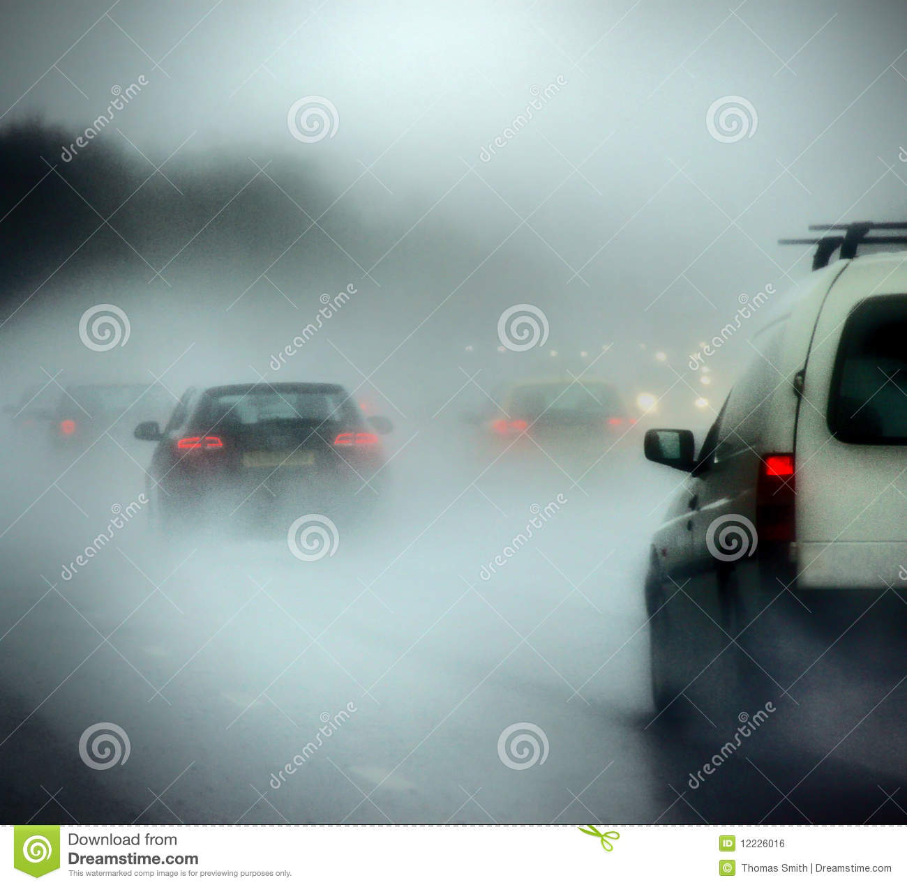 Royalty Free Stock Image: Cars on a road in heavy rain and fog