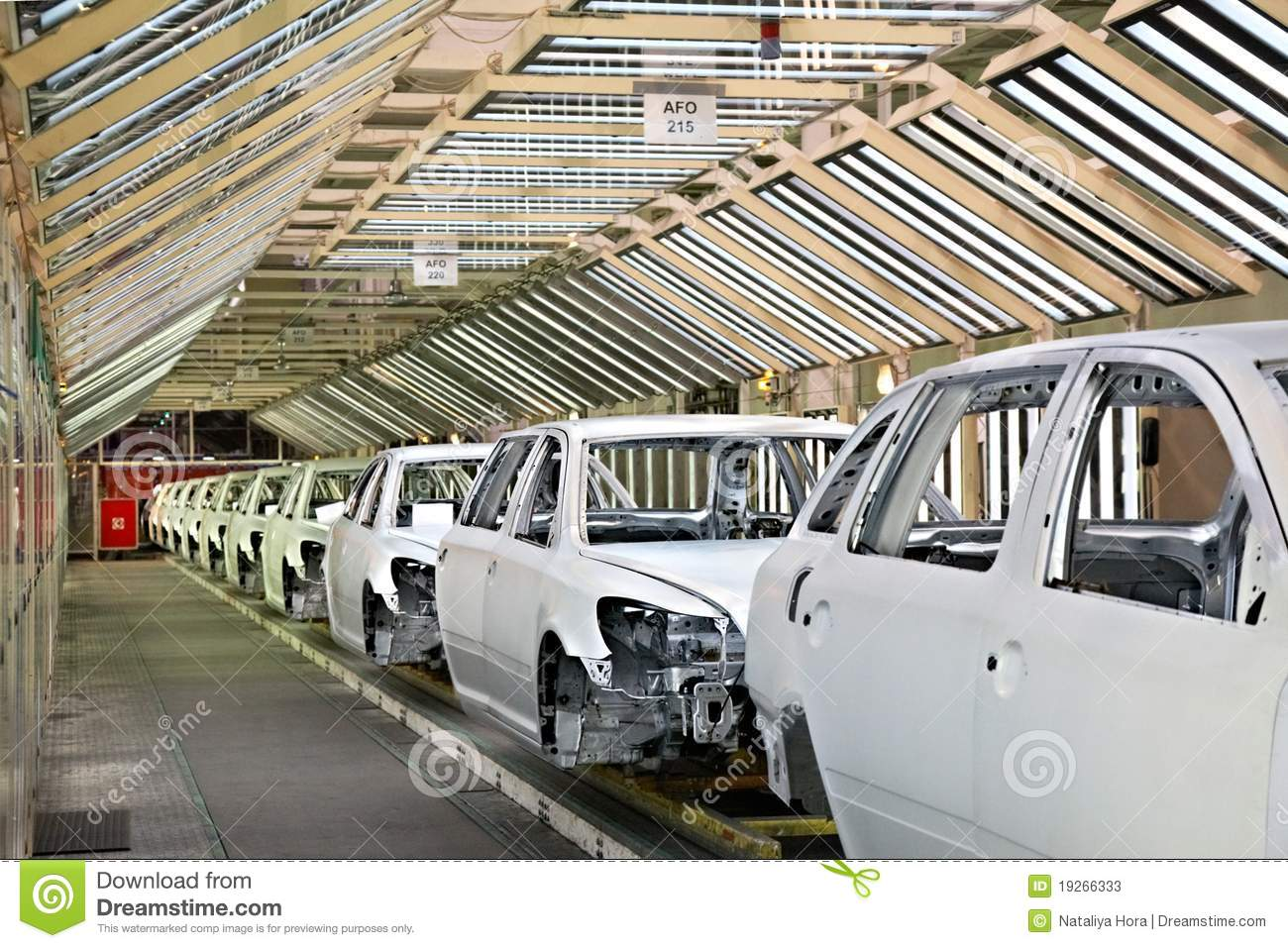 Cars in a row at car plant
