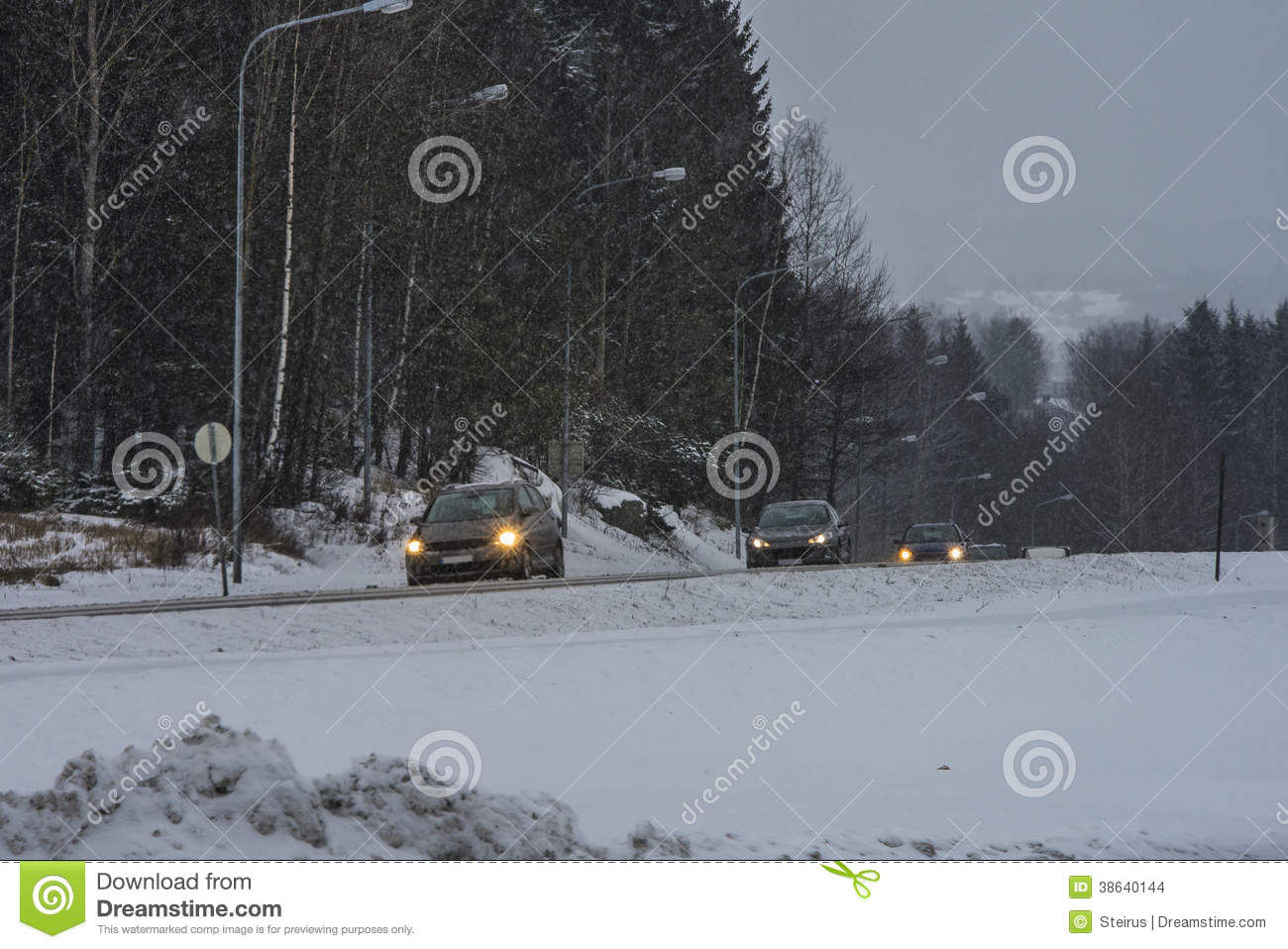 cars running in the snowy weather editorial stock image - image of