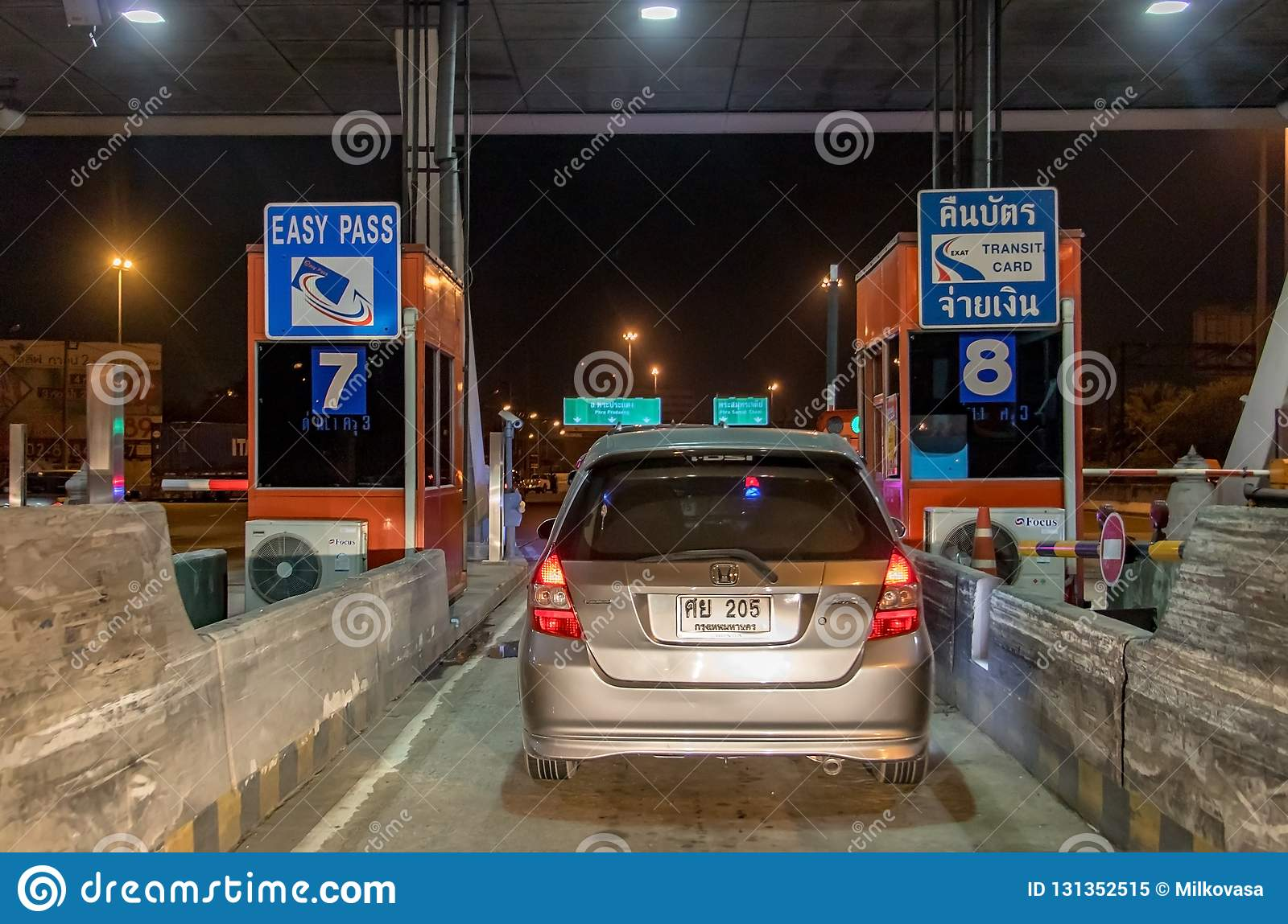 Cars standing at gate motorway entrance.