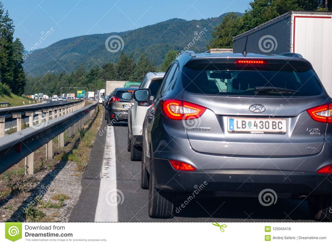 Cars Standing Still In Lines On Highway, A Car Accident