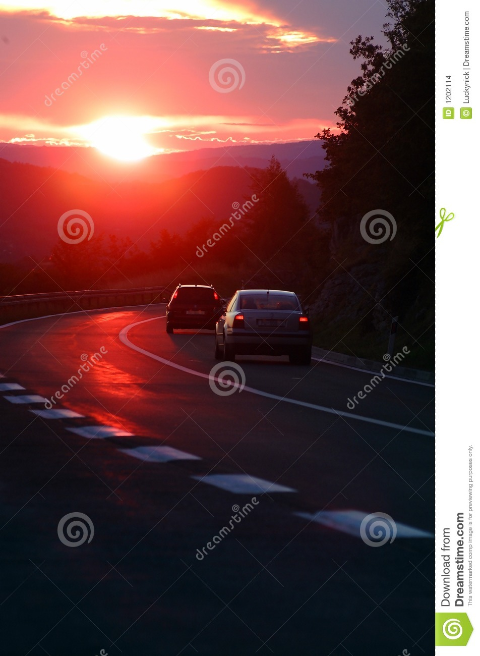 Cars in sunset