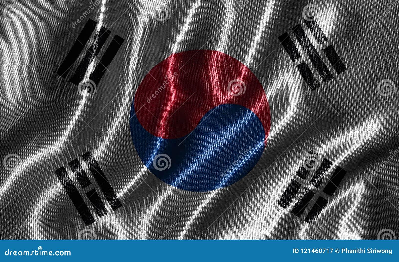 Carta da parati dalla bandiera della Corea del Sud e dalla bandiera d ondeggiamento da tessuto