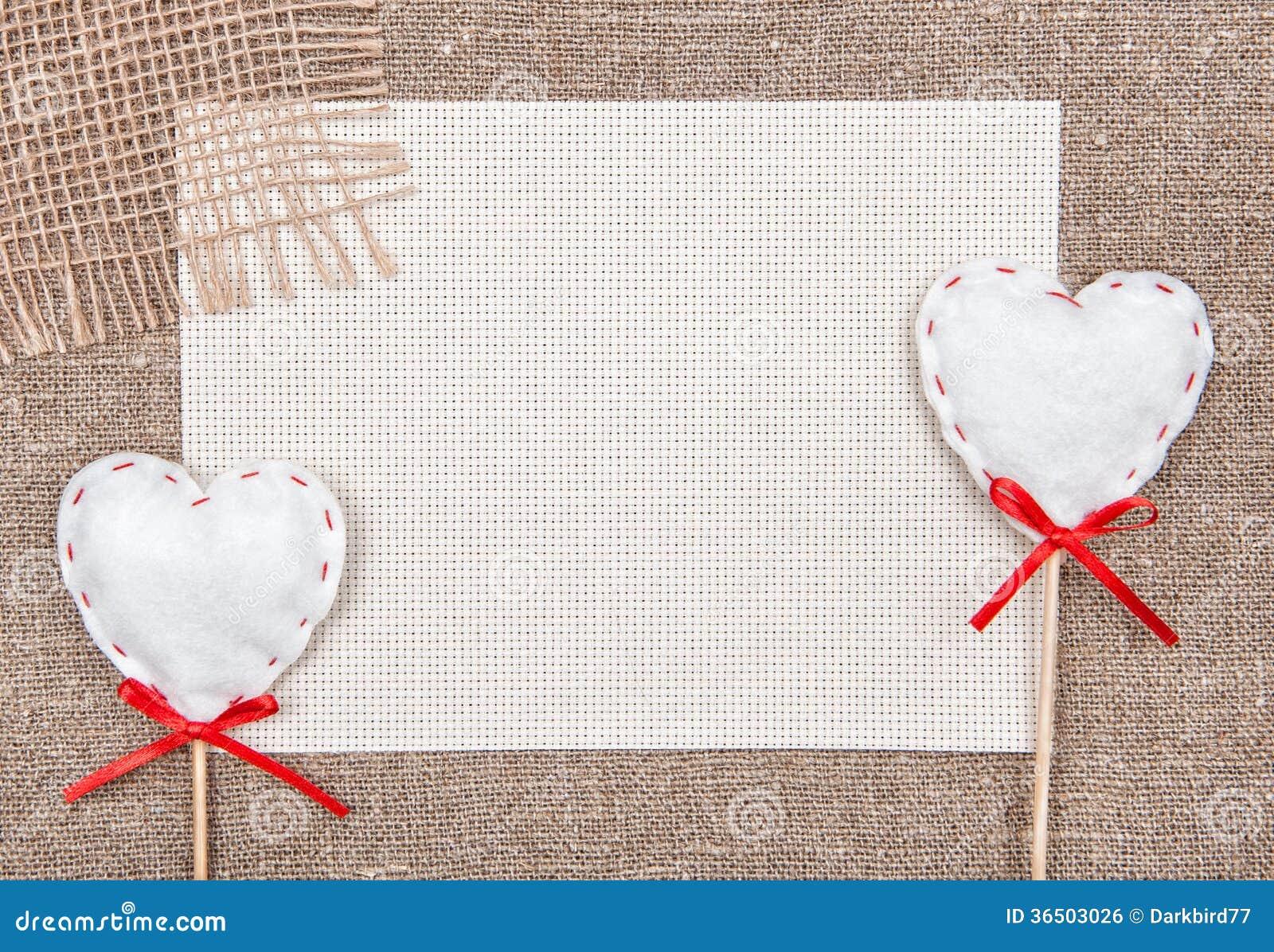 Carte de Valentine avec des coeurs et le sacki de textile
