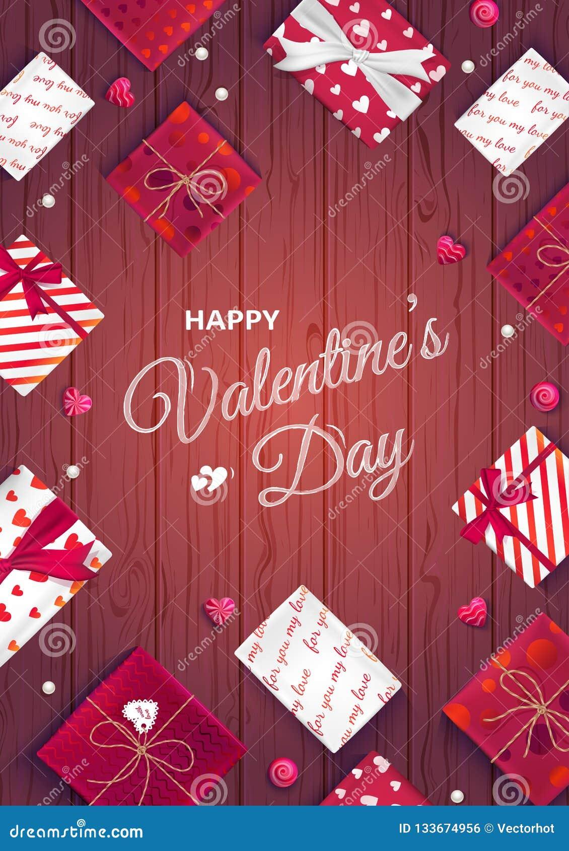 Carte de voeux heureuse de jour du `s de valentine Vue supérieure sur des boîte-cadeau dans l emballage différent, sucrerie sous
