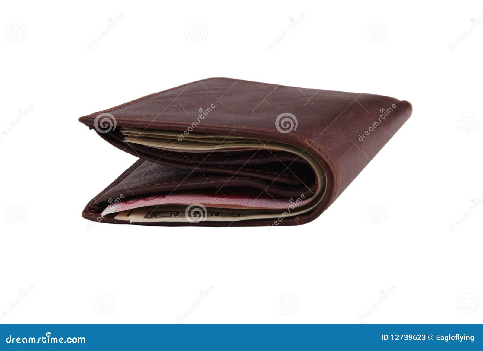 Carteira de couro de Brown enchida com as notas de banco