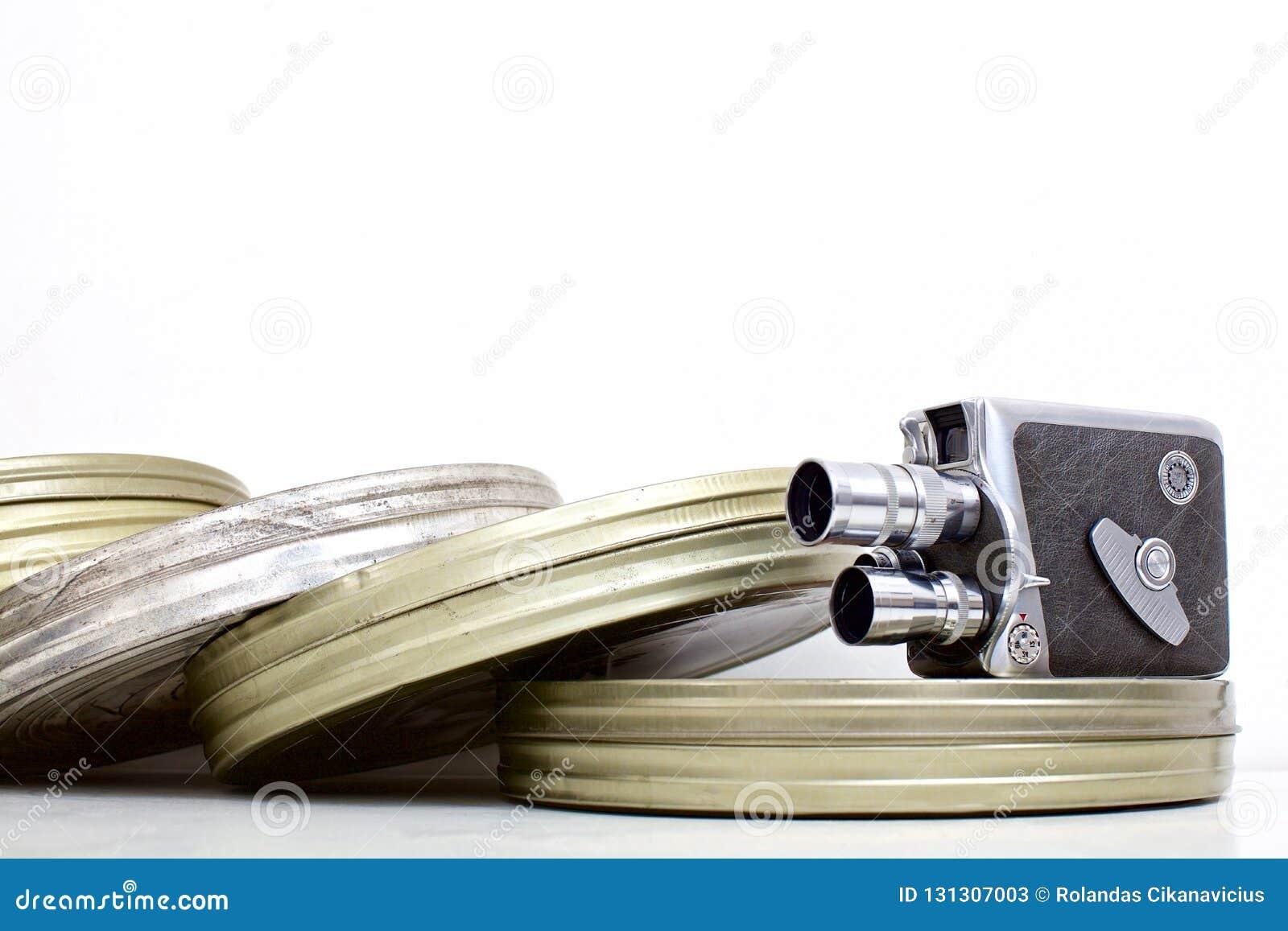 Cartuchos velhos da câmera e do filme de filme no branco