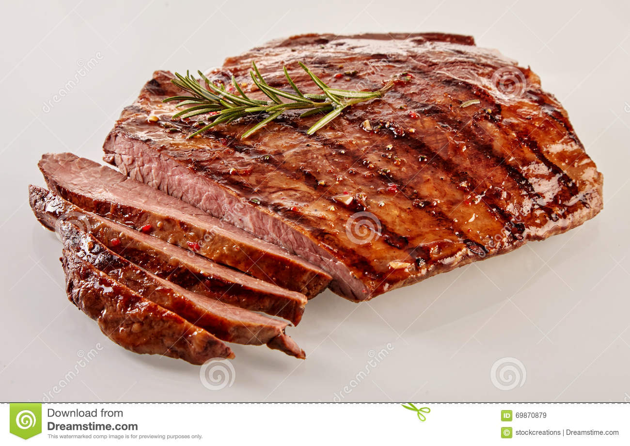 Carved barbecued medium-rare flank steak