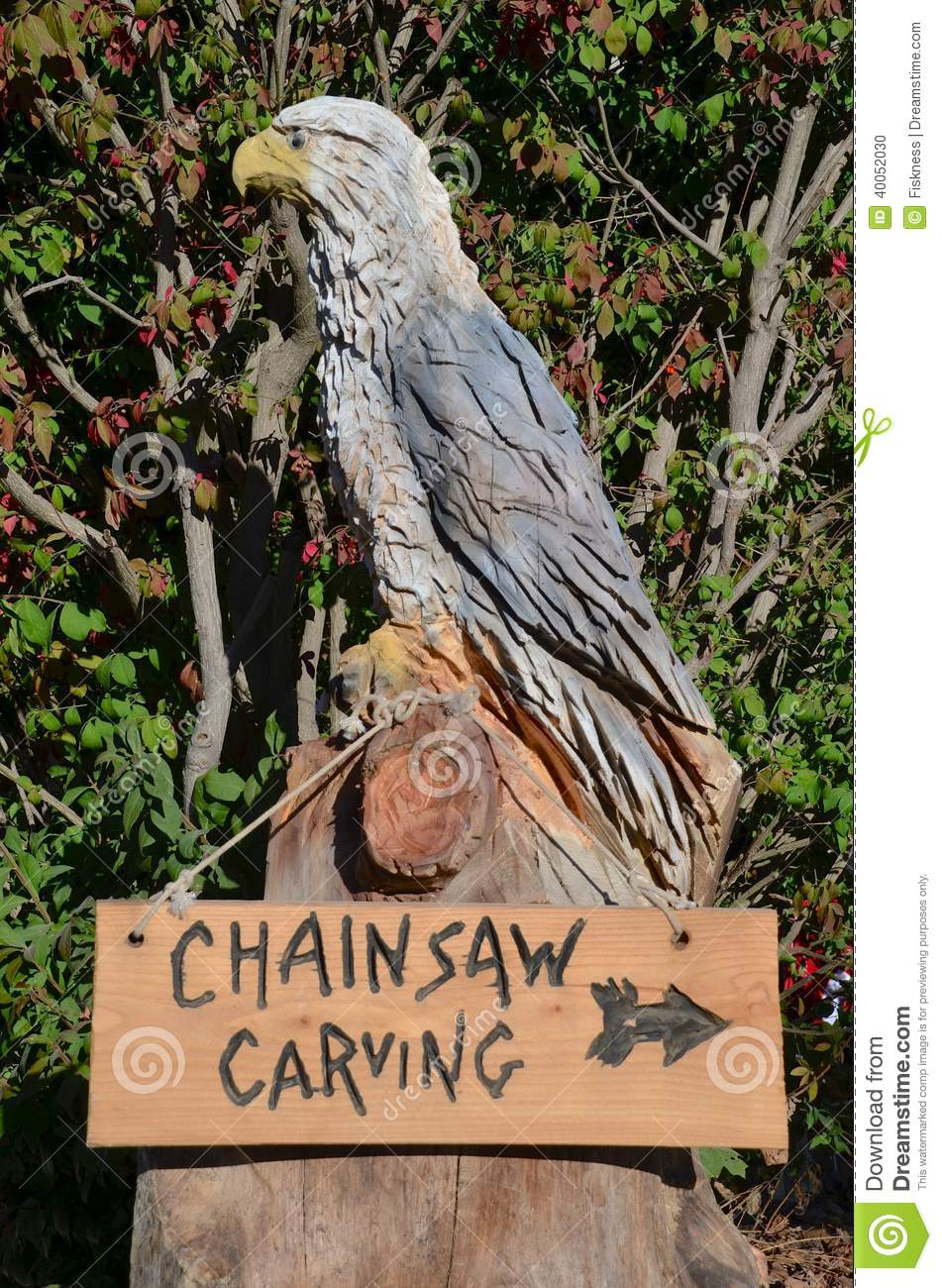 Carved eagle advertises site of wood carvings stock photo image of