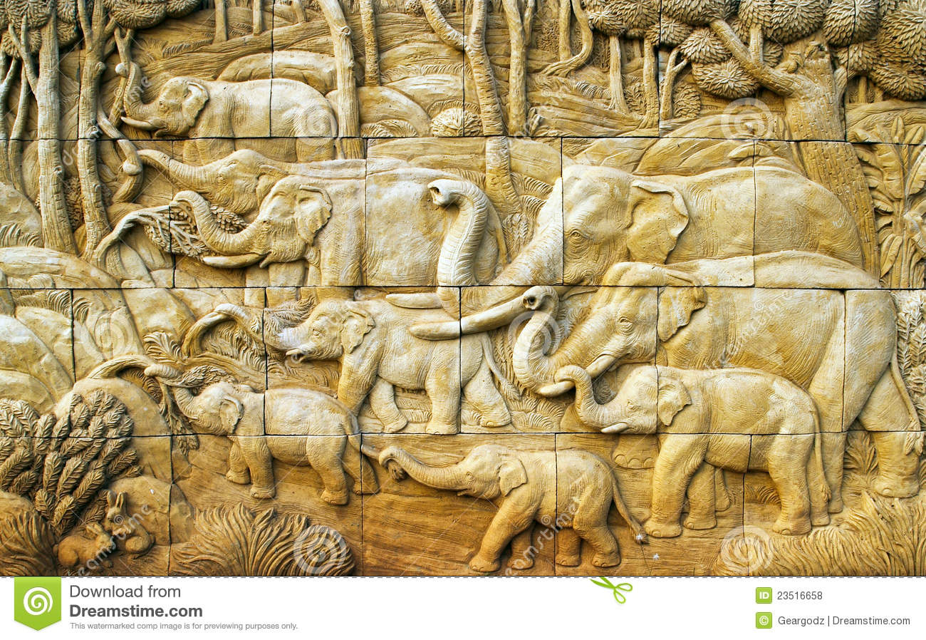 Carved elephant on stone wall stock photo image
