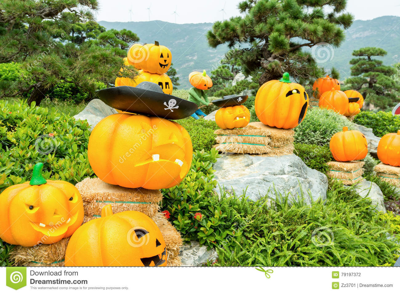 Carved golden pumpkins and background of stone and mountains stock