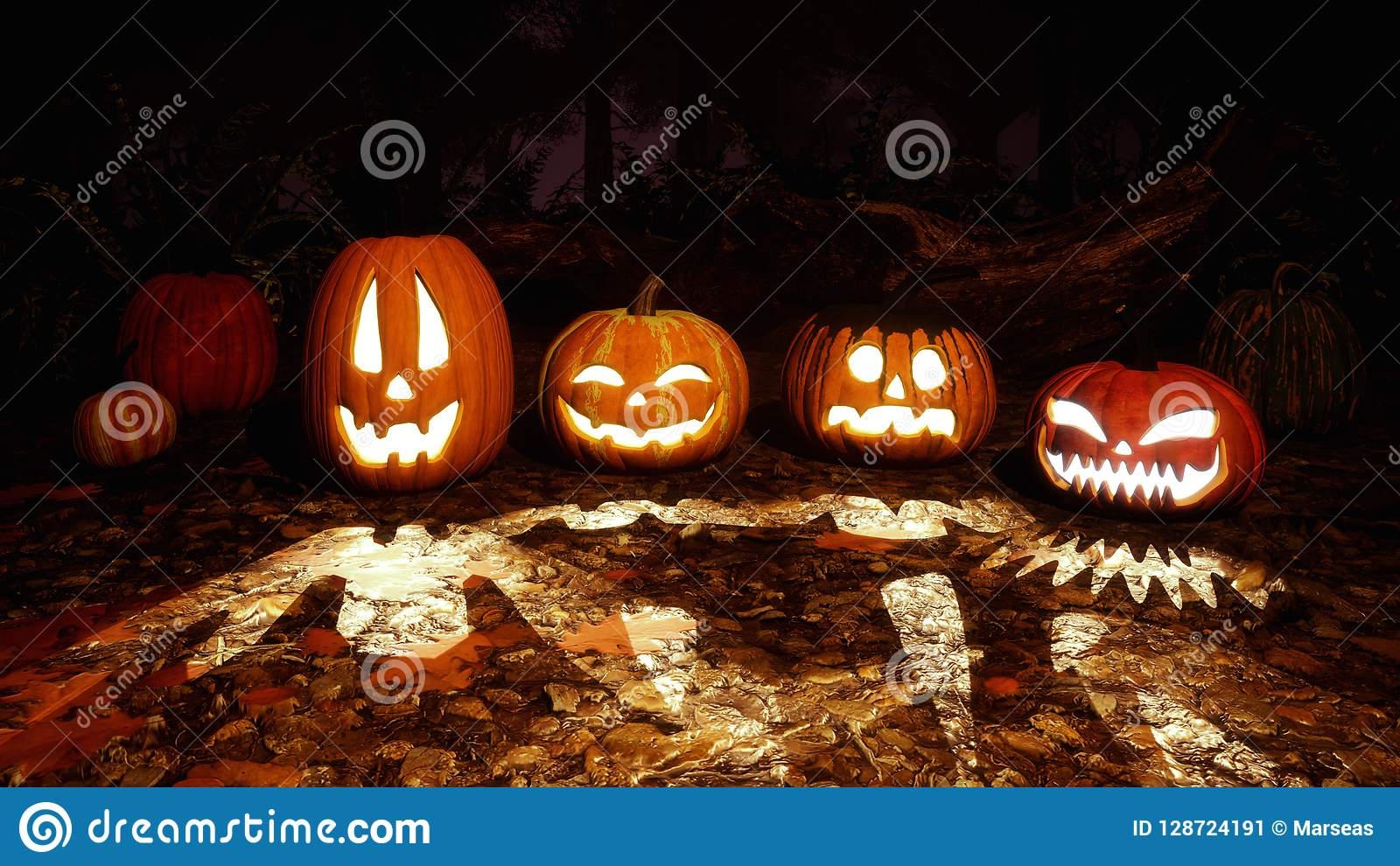Carved halloween pumpkins in night autumn forest