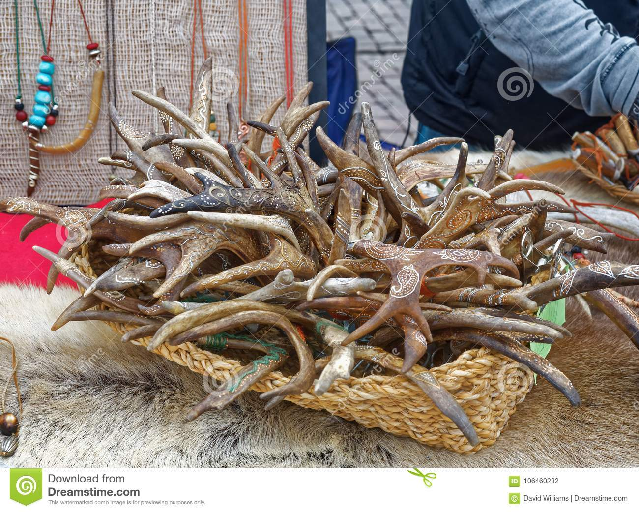 Carved and painted deer antlers in market in finland