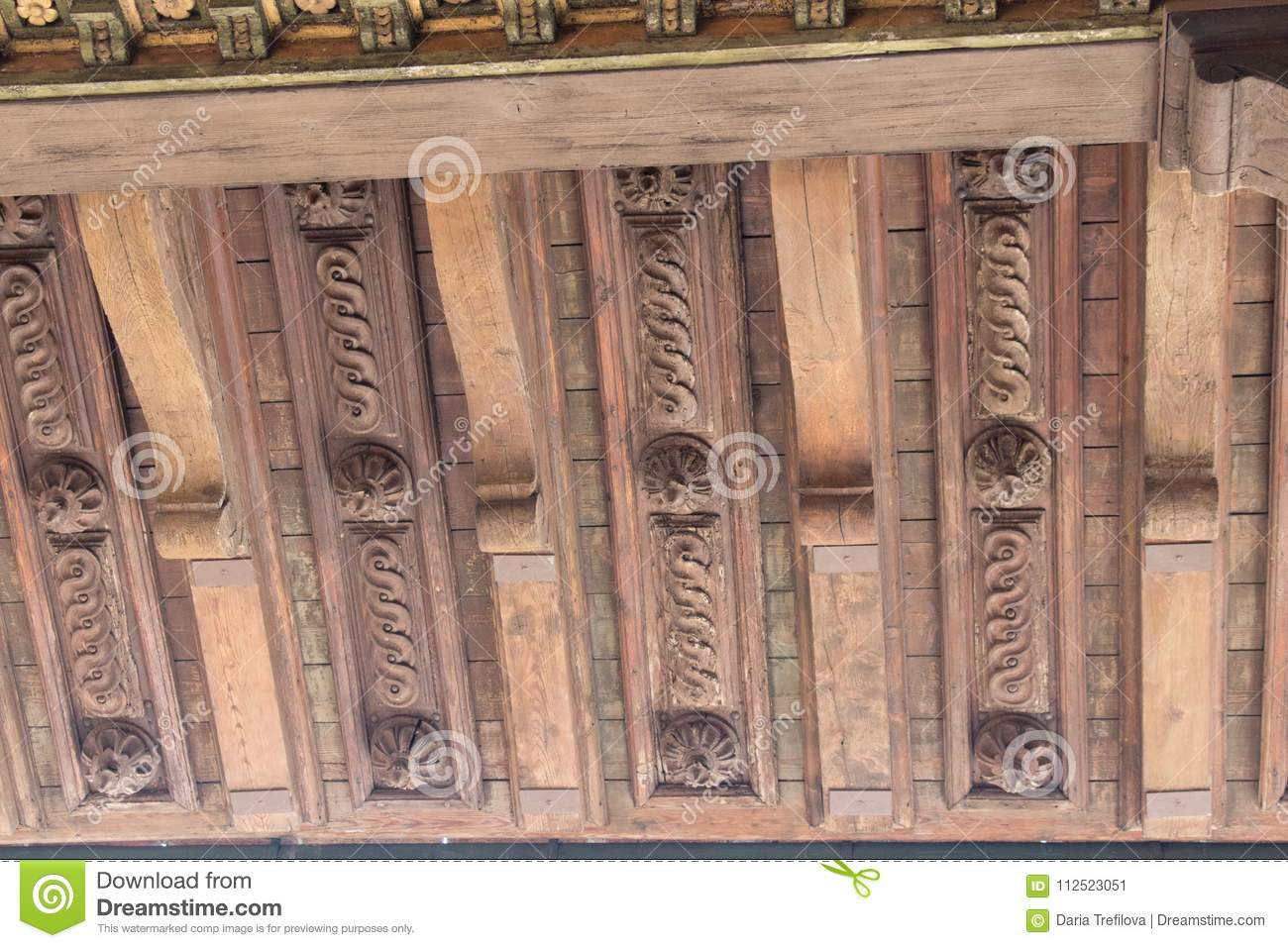 Carved roof fragment in the Terrace of Saturn at Palazzo Vecchio, Florence, Italy.