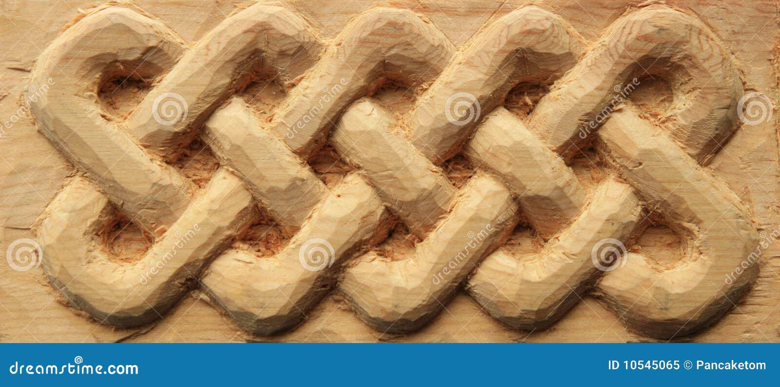 Hand carved wooden celtic interlace design.