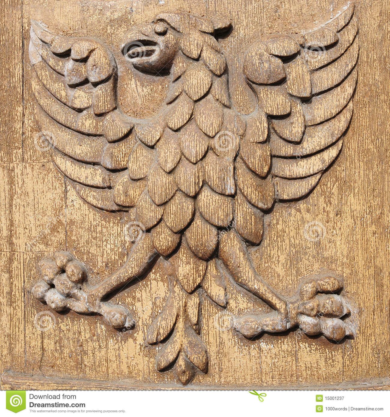 Carved wood eagle stock image of claws arms