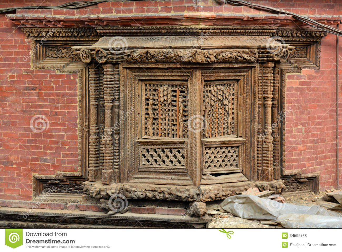 Carved wooden window in patan nepal royalty free stock for Window design in nepal