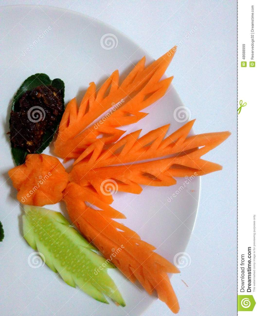 Carving carrot fruit vegetable art carve stock image