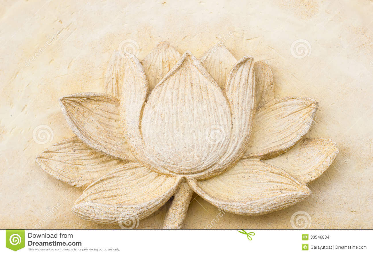 Carving clay of lotus flower on wall stock images image