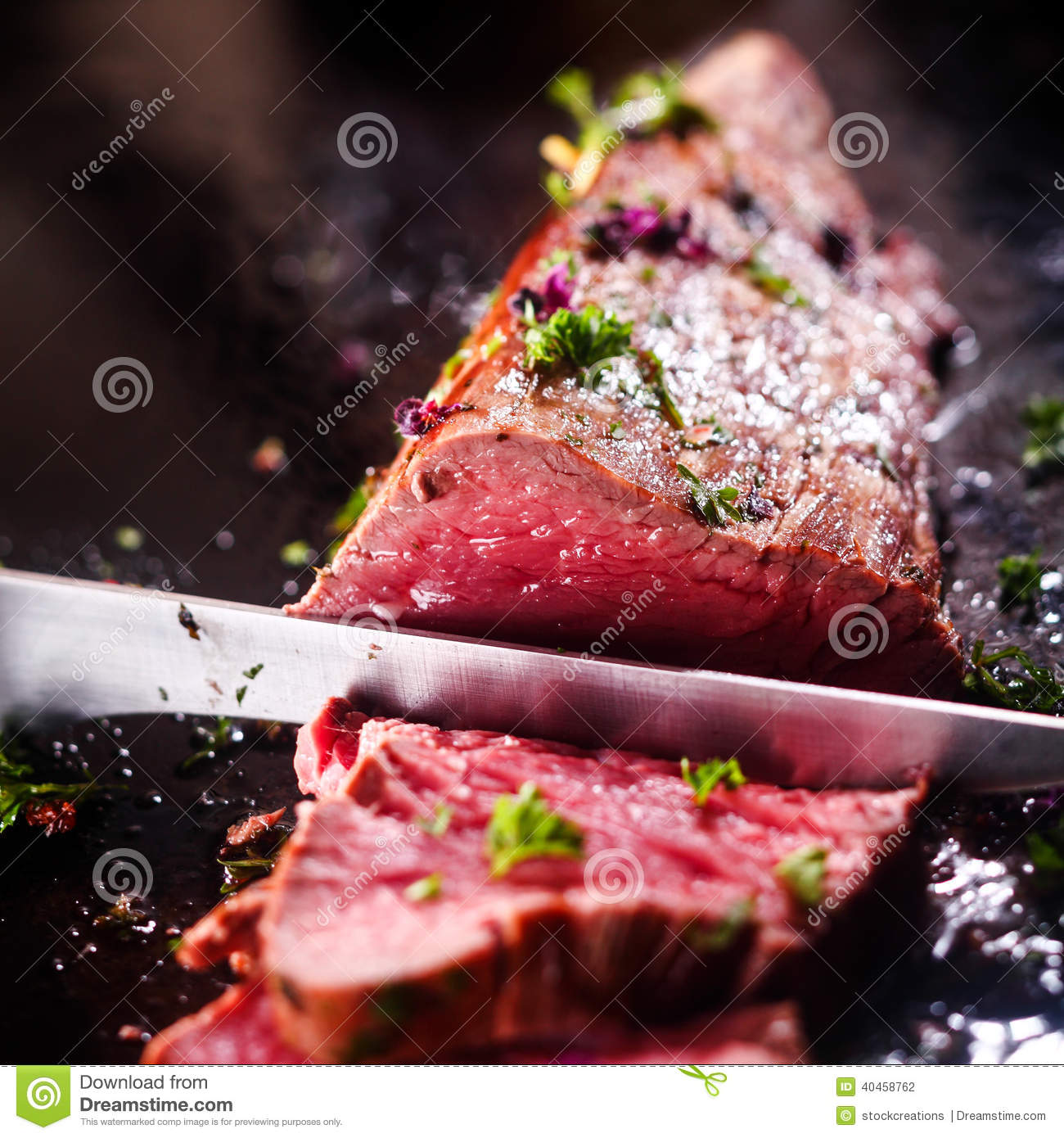Carving a portion of rare roast beef
