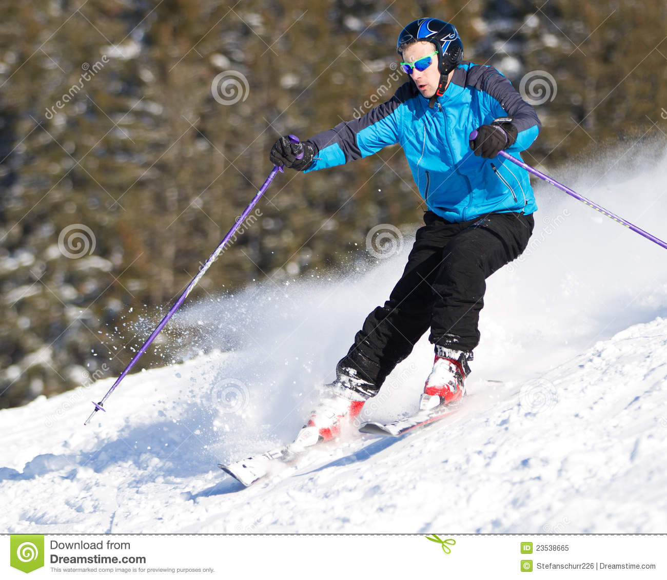 Carving skier in powder snow with spray royalty free stock