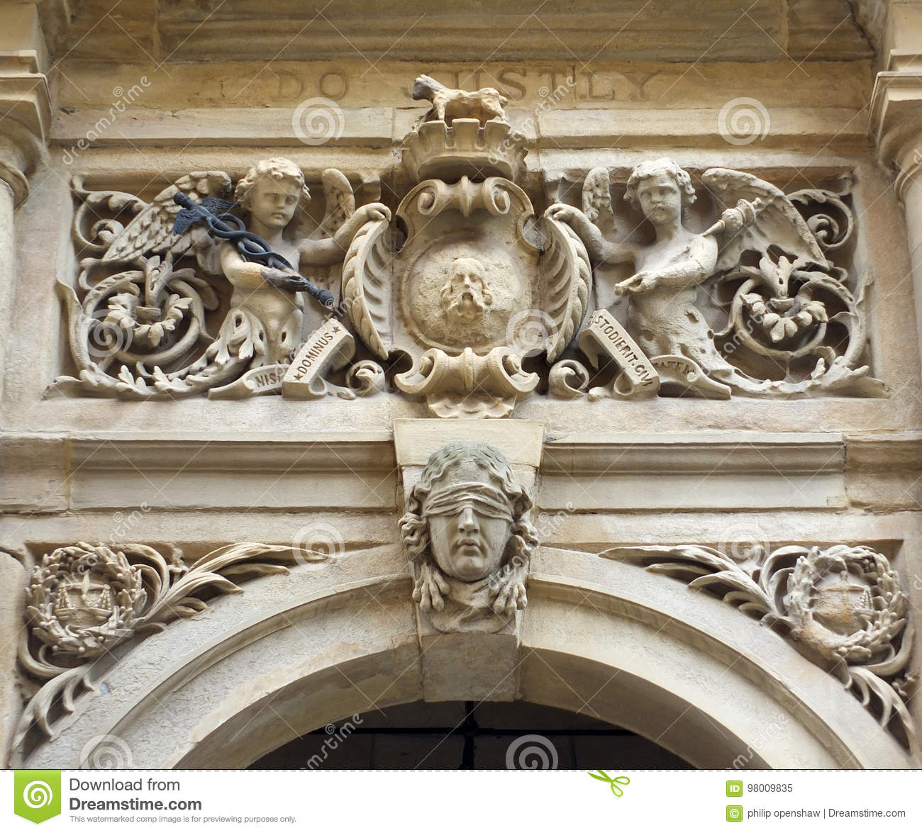 Carvings on e door of halifax town hall stock image